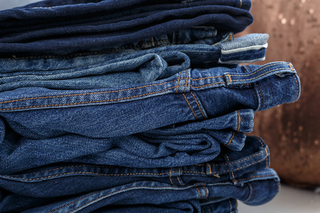 gray texture: Pile of jeans