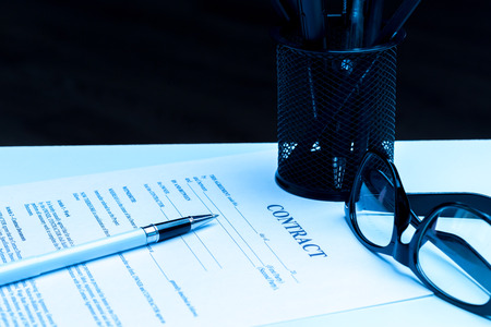 Close-up of pen on contract. Stock Photo