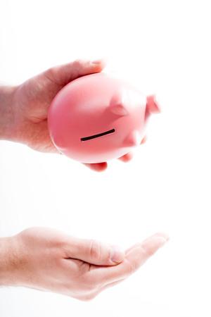 Shaking out empty piggy bank Reklamní fotografie - 85925410