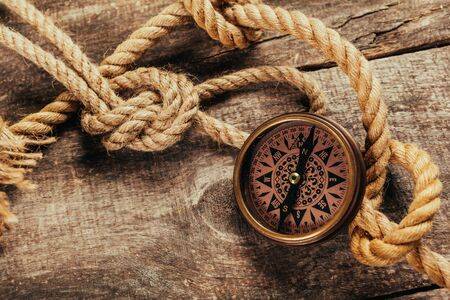 ship ropes and compass on wooden background Stockfoto