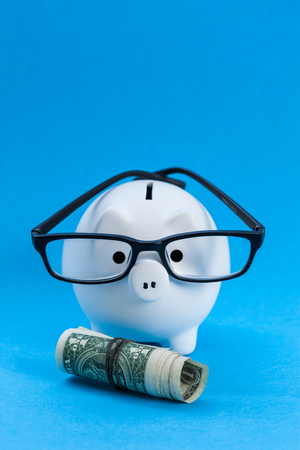 White piggy bank and US dollars Stock Photo