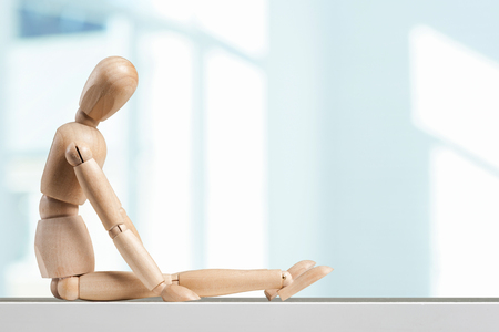 proportions of man: Wooden figure on the table