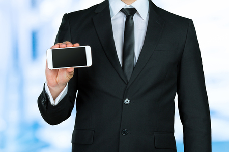 Close up of a businessman using mobile smart phone
