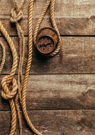 ship ropes and compass on wooden background Stock Photo