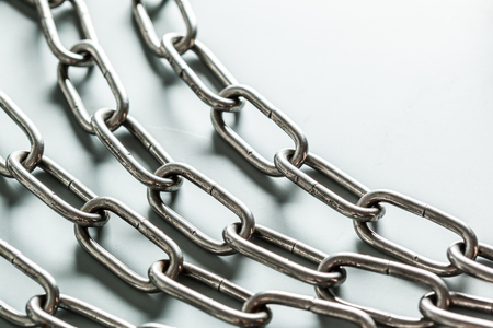 heavy industry: close up of metal chain part on white background Stock Photo