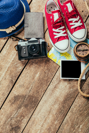 money packs: Set of trip stuff on wooden background
