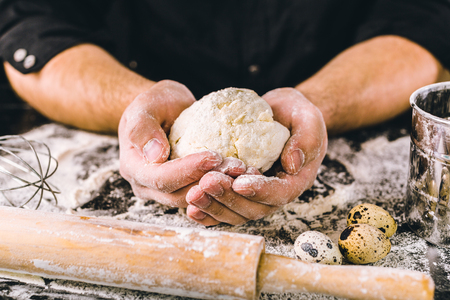 counter top: Hands kneading a dough