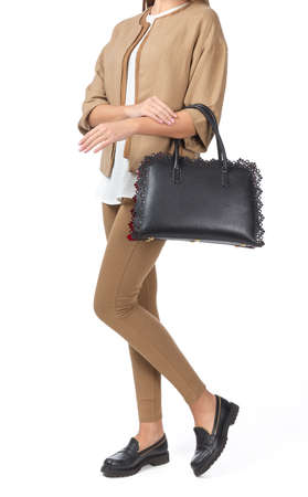 Woman holding a handbag isolated on white background Stock Photo