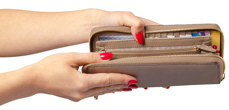 womens hands holding leather wallet