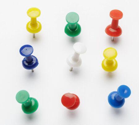 Push pins isolated on white background.