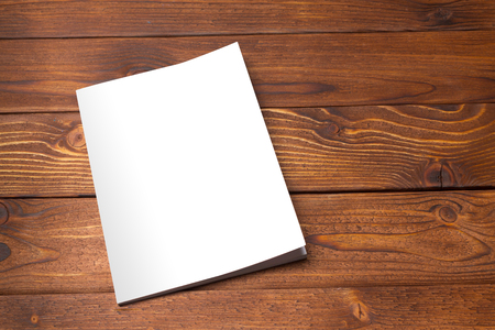 old photo: Blank book or magazine cover on wood background Stock Photo