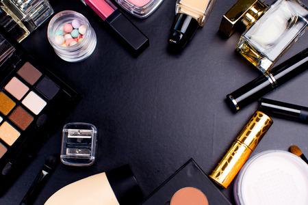 eyemakeup: Cosmetics on dark background, closeup