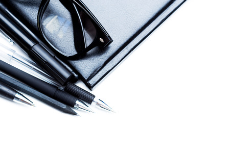 sheet: Notebook, pencil and glasses