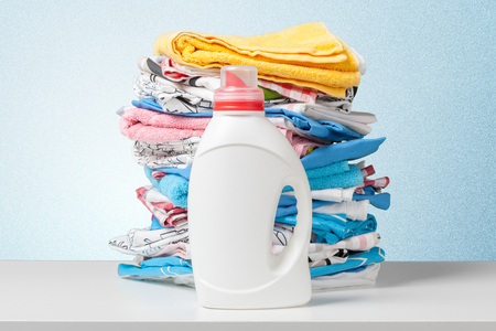 heap: Colorful towels and liquid laundry detergent