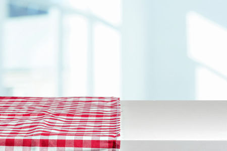 table covered with tablecloth.
