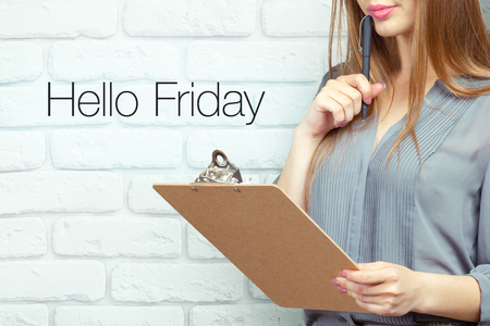 businesswoman with clipboard and pen making notes and standing near text: hello friday