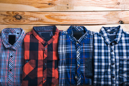 shirts plaid in plan with wooden background Stock Photo