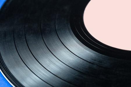 grooves: Retro vinyl record on blue background