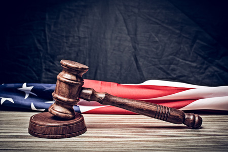 the judge gavel and background with usa flag Stock Photo