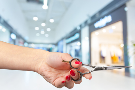 salon: womans hand holding scissors