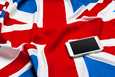 smart phone or cell phone over United kingdom flag