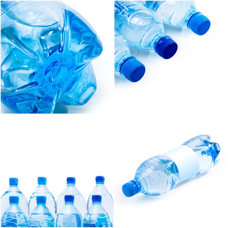 plastic bottles of water on white background