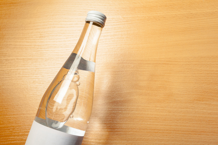 water bottle on the wooden table Stock Photo