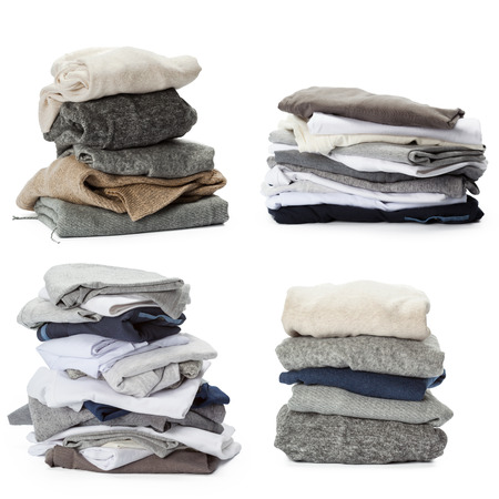 Stack of clothes isolated on white background Stock Photo