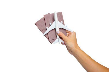Hand holding passport isolated on white Stock Photo