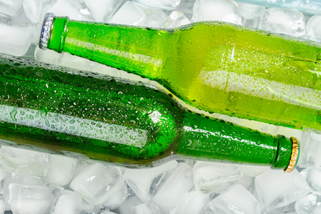 condensacion: Bottles of cold and fresh beer with ice