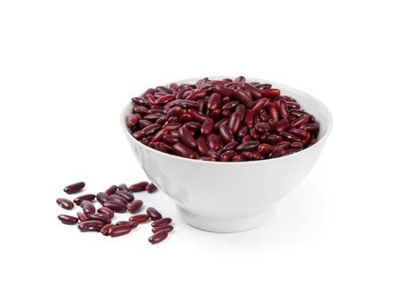 legumbres secas: frijol rojo aislado en el fondo blanco Foto de archivo