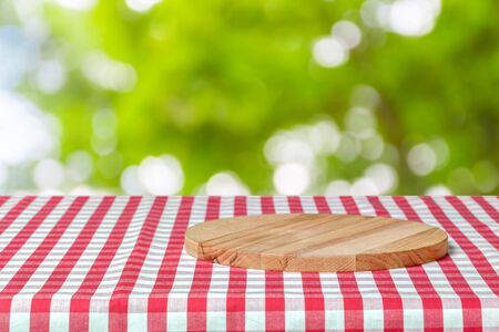 Background with tablecloth on wooden table