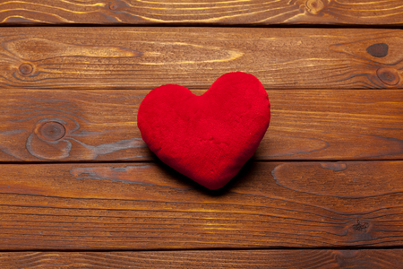 Red Valentine heart on the table Stock Photo