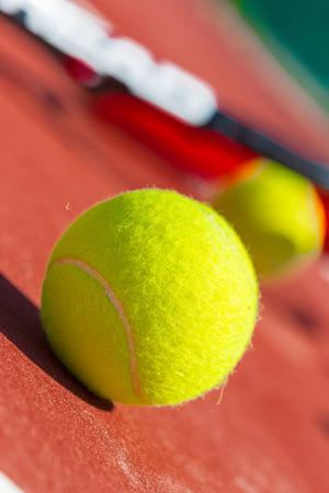 net: Tennis balls and racket on the grass court