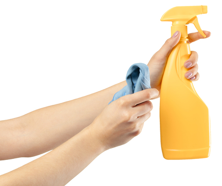 Hand with a cleaning product