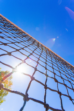 game over: Tennis net on blue sky