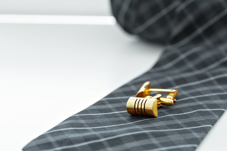 tie and cufflinks on the table . Stock Photo