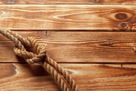 ship rope at wooden background Stock Photo