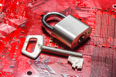 microprocessor: padlock on a computer circuit board
