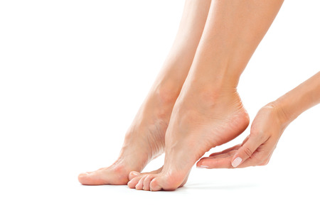 美しい女性の足は白のクローズ アップに分離 写真素材
