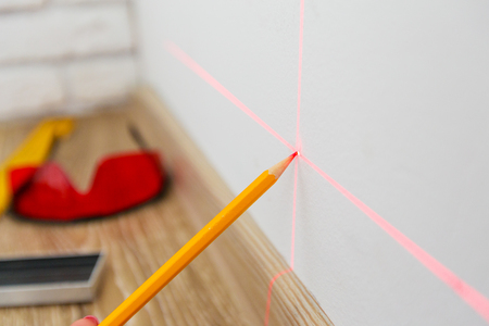 Laser level and lines on the wall Stock Photo