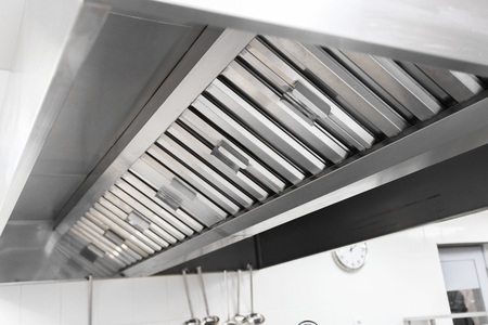 Steel shiny clean cooker hood in a restaurant 免版税图像 - 94357997