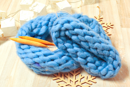 Blue knitted hat in composition Stock Photo