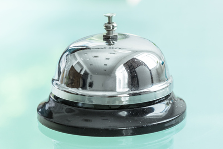 service bell on reception in hotel or restaurant Stock Photo