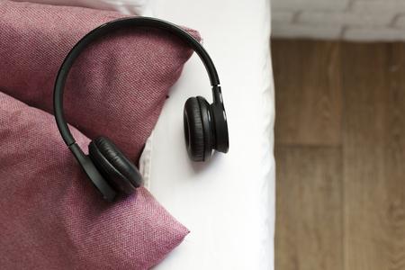 headphone lying on pillow for listening relax music Stock Photo