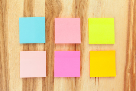 Blank sticky paper note on wall Stock Photo
