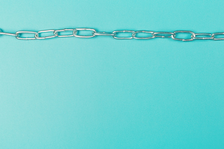 Metal chain isolated on blue background Stock Photo