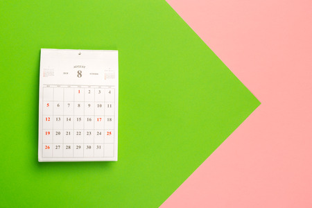 Calendar page on bright bicolor background, top view Stock Photo