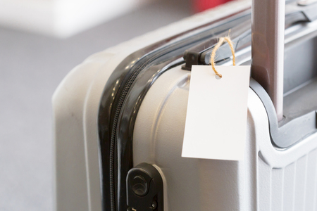 Close up of blank  luggage tag label on a suitcase Banco de Imagens