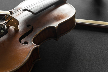 Old violin on a black background Standard-Bild